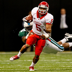 November 10, 2011; New Orleans, LA, USA; Houston Cougars running back Charles Sims (5)  breaks a tackle of Tulane Green Wave defensive end Julius Warmsley (92) during the second quarter at the Mercedes-Benz Superdome.  Mandatory Credit: Derick E. Hingle-US PRESSWIRE