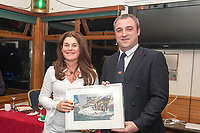 Johanna Murphy Cortegada receives prize from Kieran O'Connell Commodore Scora.