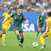 GRENOBLE, FRANCE June 18.  Emily Gielnik #15 of Australia defends by Khadija Shaw #11 of Jamaica an Chantelle Swaby #4 of Jamaica during the Jamaica V Australia, Group C match at the FIFA Women's World Cup at Stade des Alpes on June 18th 2019 in Grenoble, France. (Photo by Tim Clayton/Corbis via Getty Images)