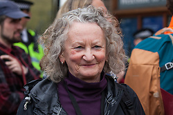 London, UK. 23rd April 2019. Jenny Jones, Baroness Jones of Moulsecoomb, attempts to assist climate change activists from Extinction Rebellion in Parliament Square in arranging for delivery of letters to their Members of Parliament requesting meetings to discuss the issue of climate change.