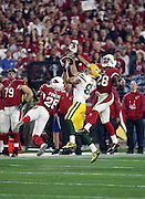 Arizona Cardinals free safety Rashad Johnson (26) and Arizona Cardinals cornerback Justin Bethel (28) break up a deep pass intended for Green Bay Packers wide receiver Jeff Janis (83) late in the fourth quarter during the NFL NFC Divisional round playoff football game against the Arizona Cardinals on Saturday, Jan. 16, 2016 in Glendale, Ariz. The Cardinals won the game in overtime 26-20. (©Paul Anthony Spinelli)