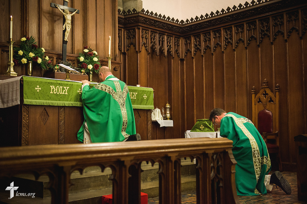 The Rev. Douglas Spittel, senior pastor, and associate pastor, the Rev. Eric R. Andræ, kneel during worship at First Trinity Evangelical–Lutheran Church on Sunday, Nov. 20, 2016, in Pittsburgh. LCMS Communications/Erik M. Lunsford