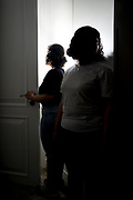 Reem (left) and her younger sister Rawan stand for a photograph in a room in Hong Kong on February 25th, 2019. Reem, aged 20, and Rawan (aged 18) (not their real names) fled from their abusive family and Saudi Arabia's oppressive conditions while on holiday in Sri Lanka and were intercepted in Hong Kong on their way to Australia to seek asylum. <br /> Photo by Suzanne Lee/PANOS for TIME