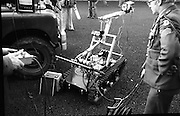 Bomb Disposal Robot.   (J97)..1975..29.12.1975..12.29.1975..29th December 1975..At Clancy Barracks,Dublin the Irish army put on display their newly aquired Bomb Disposal Robot. It would be invaluable in inspecting suspect buildings or vehicles. The series of pictures shows the army demonstration of the equipment..Image shows the operator checking the operation of the onboard systems and adjusting the remote monitor.