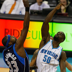 Mar 22, 2010; New Orleans, LA, USA; New Orleans Hornets center Emeka Okafor (50) and Dallas Mavericks center Brendan Haywood (33) jump for the opening tip during the first half at the New Orleans Arena. Mandatory Credit: Derick E. Hingle-US PRESSWIRE