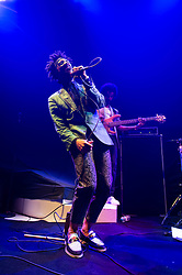 "© Licensed to London News Pictures. 27/05/2014. London, UK.   King Holiday performing live at The Roundhouse, supporting headliner Paloma Faith.   In this picture - Leslie 'Kujo' DuMouchel. King Holiday is an American 10-piece soul/psychedelic rock/jazz/funk  band led by founder Leslie 'Kujo' DuMouchel & consisting of members Leslie ""Kujo"" DuMouchel (lead Vocals), Miles Spillane (Drums), Ben Lieberman (Guitar), Andrew Friedman (Bass), Chesney Pollis (Backing Vocals), Ngonda Badilla (Backing Vocals). Photo credit : Richard Isaac/LNP"