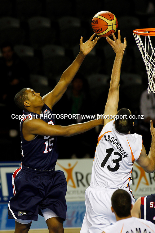 USA forward Howard Thompkins shoots as Iran's Center Sooren Derboghosian ( 13 ) attempts to block during the USA's 106-55 victory over Iran.<br />