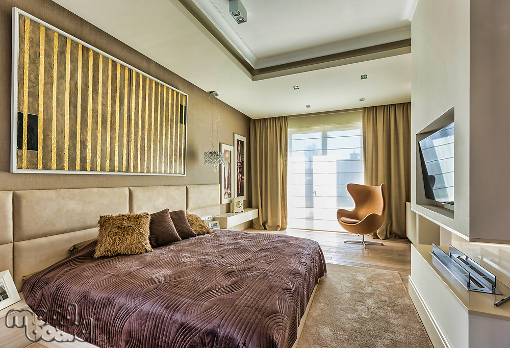 Full length view of luxurious bedroom in new apartment