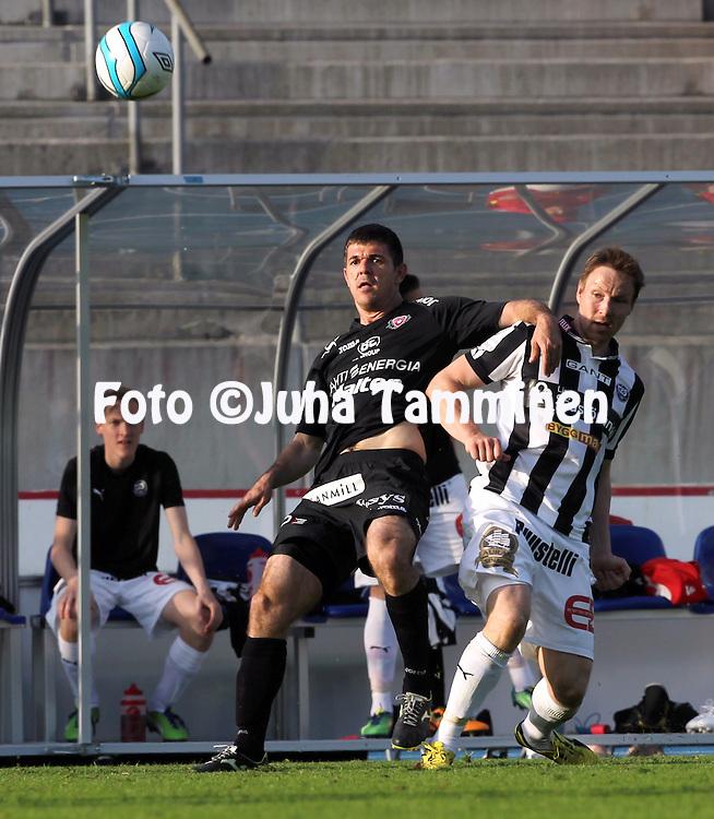 29.5.2013, Hiihtostadion, Lahti.<br /> Veikkausliiga 2013.<br /> FC Lahti - FC TPS Turku.<br /> Rafael Pires Vieira (FC Lahti) v Jaakko Nyberg (TPS).