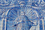 ALMANCIL, PORTUGAL - JULY 20, 2006: Exterior detail of the Saint Lawrence of Rome church in Almancil, Portugal. Church has one of the most beautiful in Portugal hand painted tiles (Azulejo) of the 18th century at the facade. This azulejo tiles depict Saint Lawrence of Rome.