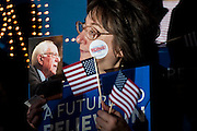 A supporter of Senator and 2016 Republican presidential candidate, Bernie Sanders (D-VT), waits for the candidate to arrive for a campaign event at Grand View University's Sisam Arena in Des Moines, IA on January 31, 2016. Sanders is in Iowa campaigning in the final days before the Iowa Caucus.<br />