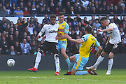 Derby County forward Tom Lawrence (10)  shoots at goal during the EFL Sky Bet Championship match between Derby County and Rotherham United at the Pride Park, Derby, England on 30 March 2019.