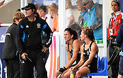 Coach Mark Hager on the sideline with Kayla Whitelock and Petrea Webster after Whitelock was sent off for having too many players on the pitch during a Black Sticks Women v England Semi Final match at the Glasgow National Hockey Stadium. Glasgow Commonwealth Games 2014. Friday 1 August 2014. Scotland. Photo: Andrew Cornaga/www.Photosport.co.nz