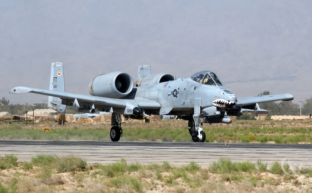 "A U.S. Air Force Fairchild-Republic A-10 Thunderbolt II aircraft takes off for a patrol from Bagram airbase June 11, 2002 in Bagram Afghanistan. The A-10, also known as the ""Warthog"", is a single seat, close air support (CAS) aircraft that is deployed to protect troops and attack ground targets in Afghanistan as part of Operation Enduring Freedom."