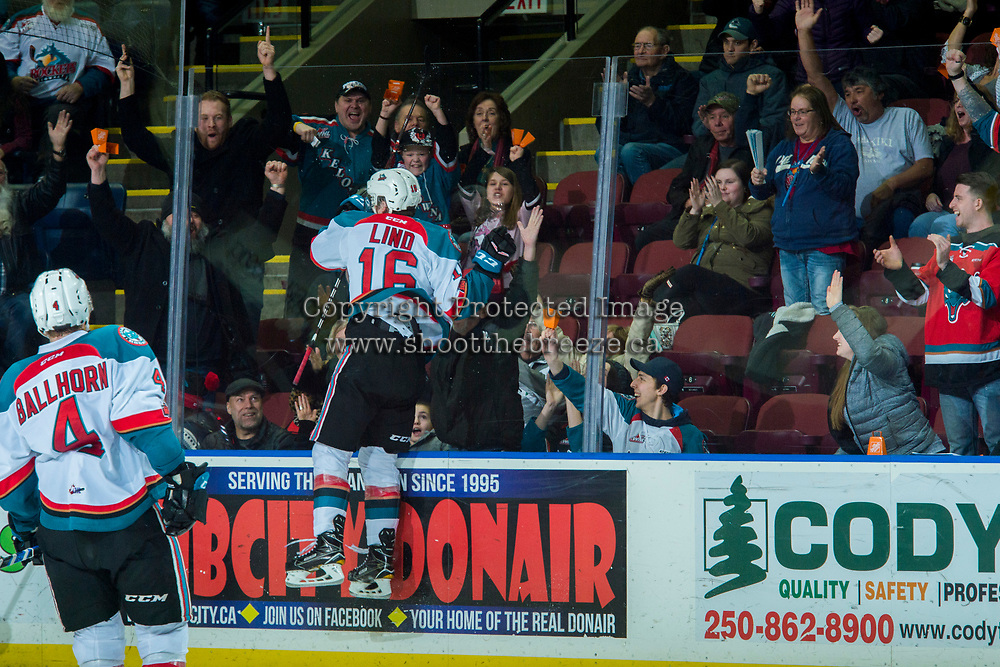 KELOWNA, CANADA - FEBRUARY 23:  Kole Lind #16 of the Kelowna Rockets jumps at the glass to celebrate a goal with fans against the Seattle Thunderbirds on February 23, 2018 at Prospera Place in Kelowna, British Columbia, Canada.  (Photo by Marissa Baecker/Shoot the Breeze)  *** Local Caption ***