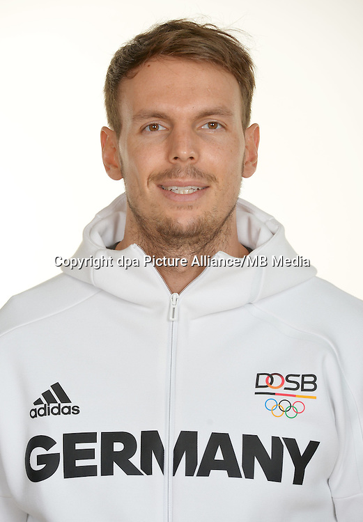 Kai Häfner poses at a photocall during the preparations for the Olympic Games in Rio at the Emmich Cambrai Barracks in Hanover, Germany. July 27, 2016. Photo credit: Frank May/ picture alliance.   usage worldwide