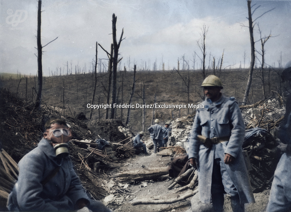"Colorized photographs soldiers from the World War One<br /> <br /> With his impressive colorized photographs of the World War One, Frédéric Duriez gives us a new look at the conflict that ravaged the world between 1914 and 1918, revealing the difficult daily life of the French soldiers. <br /> <br /> Photo Shows: ""Wood of the Caillette - 1916 - Soldier trying a German mask found on the ground<br /> ©Frédéric Duriez/Exclusivepix Media"