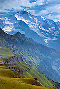 "From Männlichen, see Jungfrau (""The Virgin"" 4158 meters or 13,642 feet elevation) and Lauterbrunnen Valley in the Berner Oberland, Switzerland, the Alps, Europe. UNESCO lists ""Swiss Alps Jungfrau-Aletsch"" as a World Heritage Area (2001, 2007). The Bernese Highlands are the upper part of Bern Canton, Switzerland. Published in Wilderness Travel Catalog of Adventures 1995, 1991."