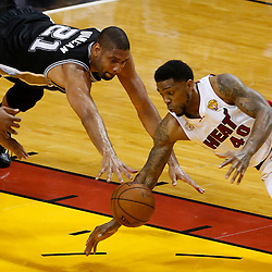 Jun 20, 2013; Miami, FL, USA; San Antonio Spurs power forward Tim Duncan (21) and Miami Heat power forward Udonis Haslem (40) battle for a loose ball during the second quarter of game seven in the 2013 NBA Finals at American Airlines Arena. Mandatory Credit: Derick E. Hingle-USA TODAY Sports