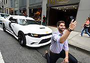Fred Fontes Gerards takes a selfie after taking a free Uber ride in a Hot Wheels Star Wars First Order Stormtrooper Dodge vehicle, modeled after the new Hot Wheels line of Star Wars character cars, Friday, Sept. 4, 2015 in New York, to celebrate Force Friday.  (Photo by Diane Bondareff/Invision for Mattel/AP Images)