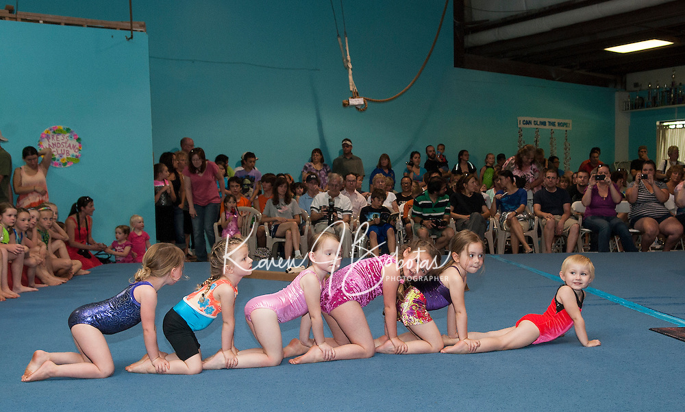 """""""Gymmy's"""" Rory Rousseau, Catherine Fay, Mary Louise Banker, Gracie Stephen, Sasha Kiel and Lyla McSheffrey do the """"caterpillar"""" during their floor time at Lakes Region Gymnastics Friday evening.  (Karen Bobotas/for the Laconia Daily Sun)"""