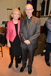 MARY BERRY and the Archbishop of Canterbury JUSTIN WELBY at the charity Child Bereavement UK's 21st Anniversary Christmas Carol Concert held at Holy Trinity Brompton, London on 10th December 2015.