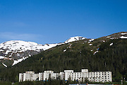 "The Buckner Building, Whittier, Alaska - ""A city under one roof"". Built in 1953, this derelict building was abandoned but can't be demolished due to the amount of asbestos inside. It was damaged by earthquake in  1964.......The strangest town in Alaska, Whittier - only reachable by tunnel or ship. It's a stop off point for Cruise ships, and the Alaska raildroad. 90% of inhabitants live in one building! Originally established as a military base during World War two."