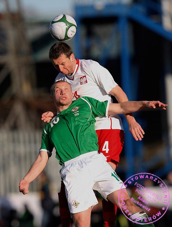 FIFA World Cup European Qualifying Group 3.Northern Ireland v Poland.Saturday 28 March 2009.Jakub Wawrzyniak of Poland and Warren Feeney of Nortern Ireland ..Photo by : Piotr Hawalej / WROFOTO
