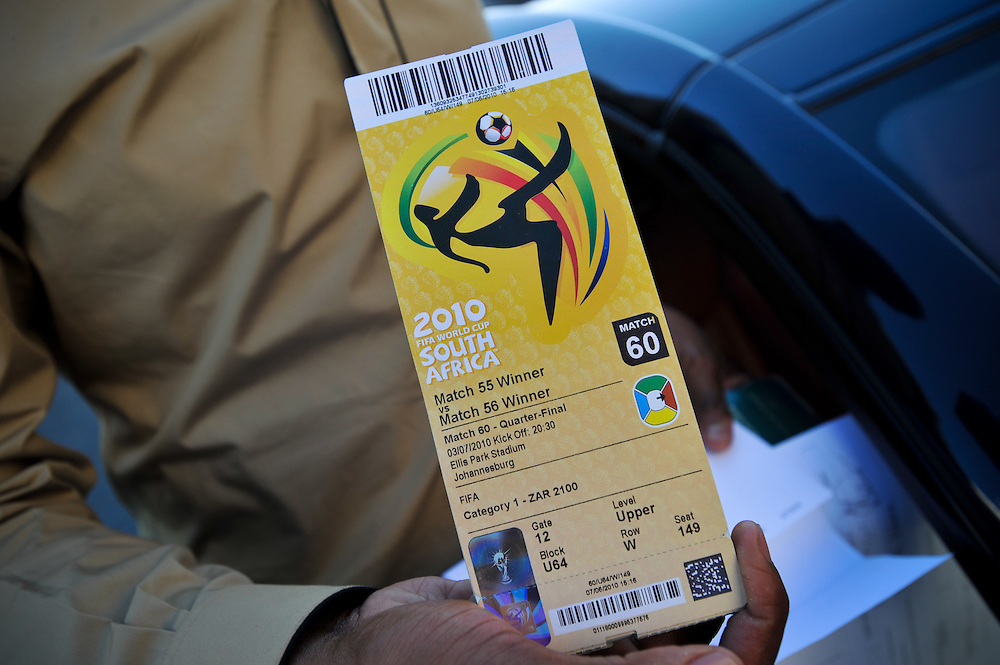 A man shows his FIFA World Cup tickets after picking them up at a ticketing center Tuesday, June 8, 2010 in Johannesburg, South Africa. Photo by Bahram Mark Sobhani