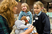 NUI Galway Medical Student Volunteer Rebecca Sherhan (Athlone ) at the Teddy Bear Hospital where Caitlin Cunningham Roisin O Meara from Kilconnell NS , Co.Galway had their sick teddys fixed. Photo:Andrew Downes..