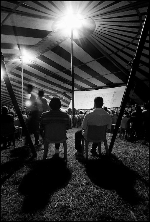 "Marville, 2002 - 40,000 Gypsies from all over the world come together and pray in Marville, a little village in France. They encanped in a former air base of NATO during 1 week. ""Vie et Lumiere"" is an International Evangelic Community  ©Jean-Michel Clajot"