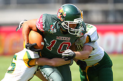 10.07.2011, Tivoli Stadion, Innsbruck, AUT, American Football WM 2011, Group A, Mexico (MEX) vs Australia (AUS), im Bild Arzate Erick  (Mexico, #10, WR) gets stopped by Chris Pearce (Australia, #25, DB) and Damien  Donaldson (Australia, #22, DB)  // during the American Football World Championship 2011 Group A game, Mexico vs Australia, at Tivoli Stadion, Innsbruck, 2011-07-10, EXPA Pictures © 2011, PhotoCredit: EXPA/ T. Haumer