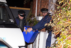 © Licensed to London News Pictures . 09/10/2012 . Altrincham , UK . Policeman pass sealed blue boxes out through the door from 1 Woodlands Road , Altrincham , Cheshire . Police arrested Jimmy Savile's former chauffeur , Ray Teret , and housemate Alan Ledger , yesterday (8th November) over historic child rape allegations . Photo credit : Joel Goodman/LNP