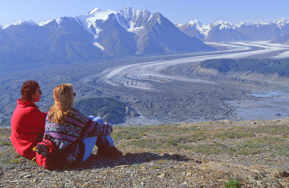Canada. Yukon . Kluane National park. Visitors dropped off by the helicopter enjoy a view of Kaskawulch Glacier.