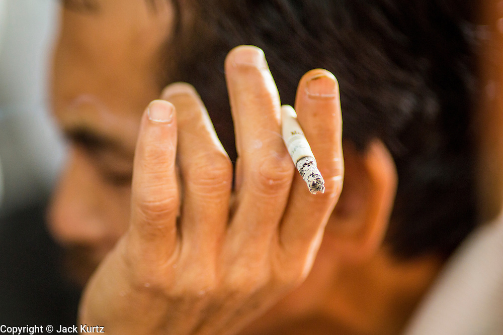 16 DECEMBER 2012 - SINGAPORE, SINGAPORE: A man smoking a cigarette in the Chinatown section of Singapore.      PHOTO BY JACK KURTZ