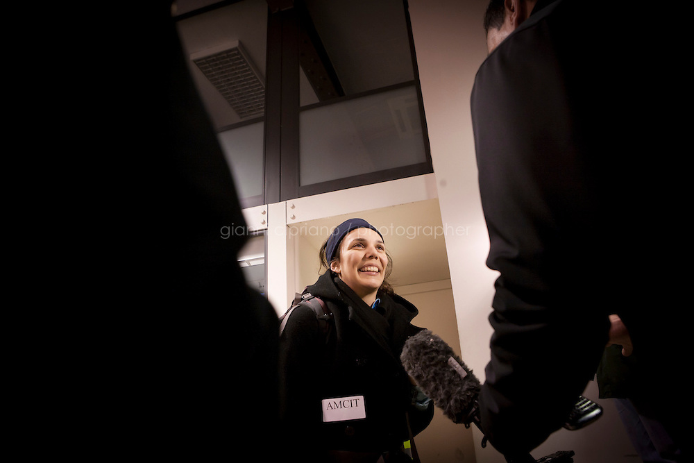 25 February 2011. Valletta, Malta. Caroline Meraz Garcia from Santa Cruz, California, arrives at the Customs in the harbor of Valletta, Malta, after stepping down from the ferry that evacuated her from Libya. In Libya, she was an English teacher at the American School. A U.S.-chartered ferry evacuated Americans and other foreigners out of Libya on Friday and brought them to the Mediterranean island of Malta. The Maria Dolores ferry, after three days of delays, brought over 300 passengers, including at 167 U.S. citizens, away from Libya where Colonel Gaddafi's forces continue to clash with anti-government demonstrators.<br /> <br /> <br /> &copy;2011 Gianni Cipriano<br /> cell. +1 646 465 2168 (USA)<br /> cell. +39 328 567 7923<br /> gianni@giannicipriano.com<br /> www.giannicipriano.com