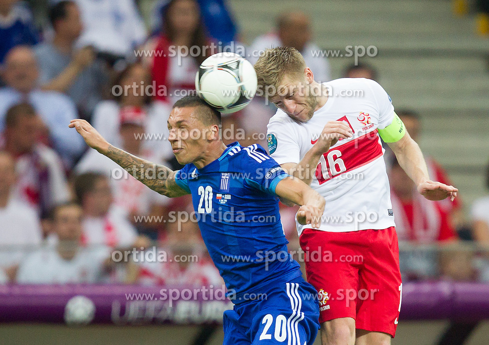 Jose Holebas  of Greece vs Jakub Blaszczykowski of Poland during the UEFA EURO 2012 group A match between Poland and Greece at The National Stadium on June 8, 2012 in Warsaw, Poland.  (Photo by Vid Ponikvar / Sportida.com)