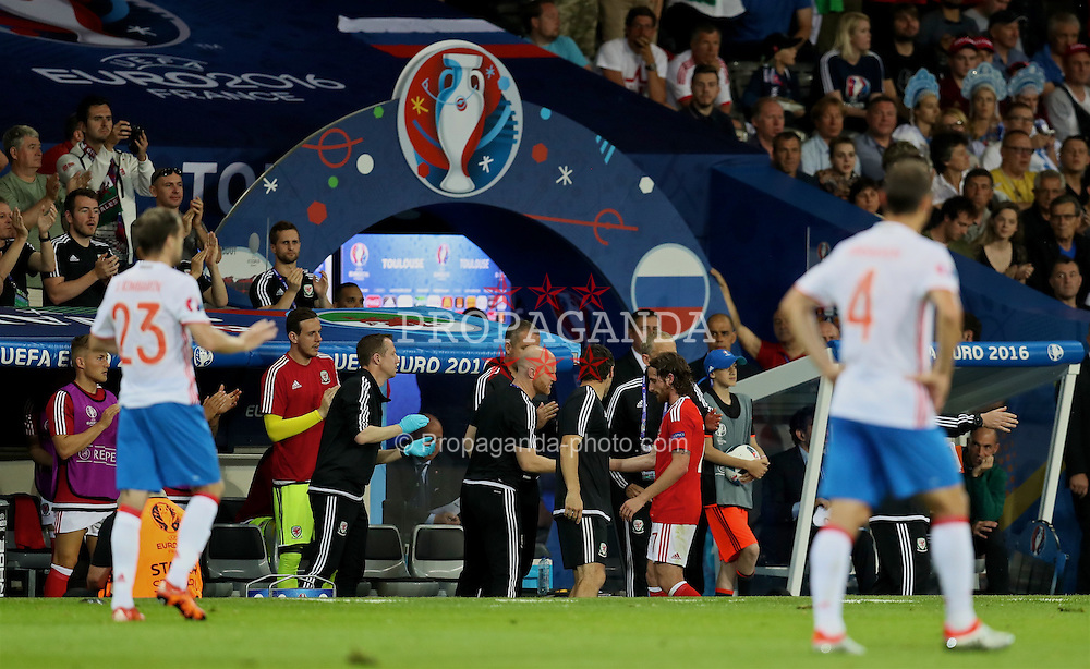 TOULOUSE, FRANCE - Monday, June 20, 2016: Wales' Joe Allen shakes is substituted during the final Group B UEFA Euro 2016 Championship match against Russia at Stadium de Toulouse. (Pic by David Rawcliffe/Propaganda)