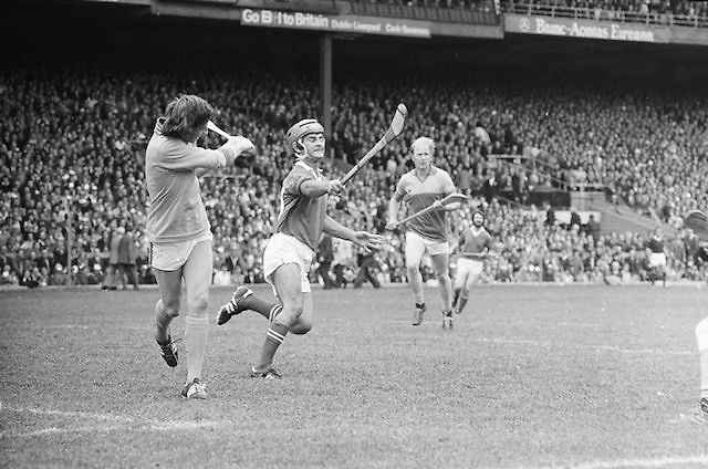 Wexford goalie hits the slitor up field as Cork fails in an attempt to block him during the All Ireland Senior Hurling Final, Cork v Wexford in Croke Park on the 5th September 1976. Cork 2-21, Wexford 4-11.