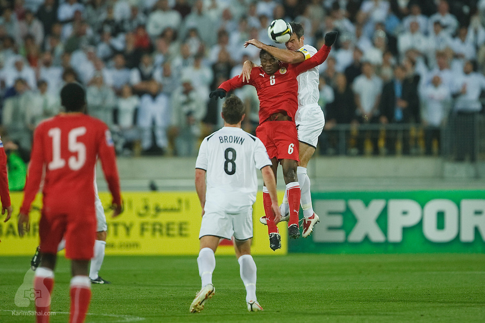 Jaycee John Okwunwanne of Bahrain and All Whites captain Ryan Nelsen jump for the ball during the second leg of the 2010 FIFA World Cup qualifying game in front a record 35,194 football fans at Westpac Stadium on November 14, 2009. New Zealand beat Bahrain 1-0 and secured a spot at the 2010 World Cup in South Africa.