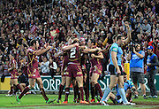 QUEENSLAND MAROONS CELEBRATE - STATE ORIGIN GAME 2 - 26TH JUNE 2013. The QLD Maroons celebrate after winning Game 2 of the 2013 State of Origin Rugby League clash against the NSW Blues played at Suncorp Stadium, Brisbane Australia. This image is for Editorial Use Only. Any further use or individual sale of the image must be cleared by application to the Manager Queensland Rugby League Commercial Department. PHOTO : SMP IMAGES