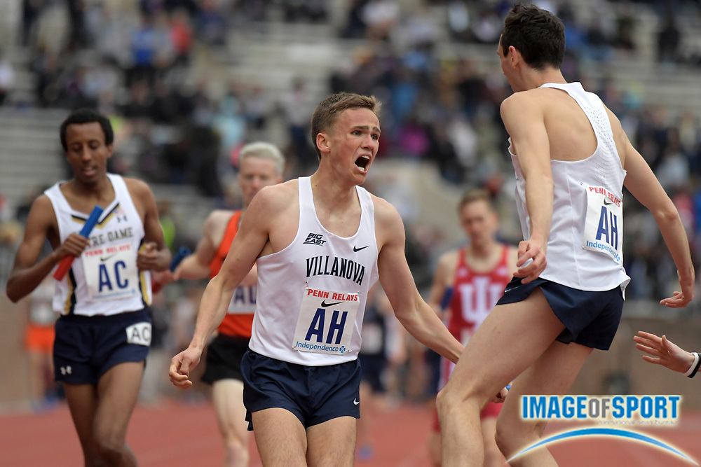 Apr 27, 2018; Philadelphia, PA, USA; Casey Comber (left) celebrates with Ben Malone after running 1,600m anchor leg on the Villanova distance medley relay that won the Championship of America race in 9:34.97 during the 124th Penn Relays at Franklin Field.