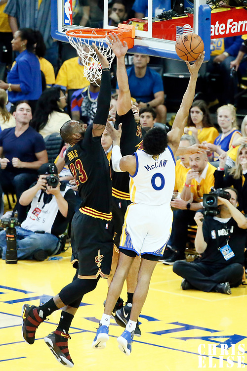 12 June 2017: Golden State Warriors guard Patrick McCaw (0) goes for the layup past Cleveland Cavaliers forward LeBron James (23) and Cleveland Cavaliers forward Richard Jefferson (24) during the Golden State Warriors 129-120 victory over the Cleveland Cavaliers, in game 5 of the 2017 NBA Finals, at the Oracle Arena, Oakland, California, USA.