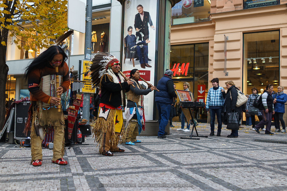 Globalisation: Ecuadorian musicians in a North American style traditional attire busking near Wenceslas Square in Prague, Czech Republic on 11 November 2014.