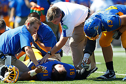 September 24, 2011; San Jose, CA, USA;  San Jose State Spartans head coach Mike MacIntyre (in white) checks on injured defensive tackle Joe Nigos (91) during the first quarter against the New Mexico State Aggies at Spartan Stadium.