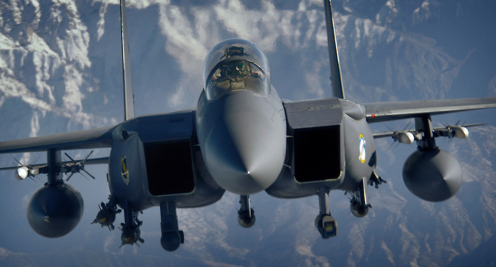 An F-15E Strike Eagle over the mountains and high desert of Afghanistan in support of Operation Mountain Lion, 12 April 2006. The crew and fighter are deployed to the 336th Expeditionary Fighter Squadron, in Southwest Asia, from the 4th Fighter Wing at Seymour Johnson Air Force Base, NC. U.S. Air Force F-15s, A-10s and B-52s are providing close-air support to troops on the ground engaged in rooting out insurgent sanctuaries and support networks. Royal Air Force GR-7s also are providing close-air support to coalition troops in contact with enemy forces. U.S. Air Force Global Hawk and Predator aircraft are providing intelligence, surveillance and reconnaissance, while KC-135 and KC-10 aircraft are providing refueling support. (U.S. Air Force photo/Master Sgt. Lance Cheung)