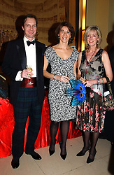 Left to right, NEIL THACKRAY, FLORENCE PAUL and SERENA BROCKBANK at 'A Rout' an evening of late evening party, essentially of revellers in aid of the Great Ormond Street Hospital Children's Charity and held at Claridge's, Brook Street, London W1 on 25th January 2005.<br />