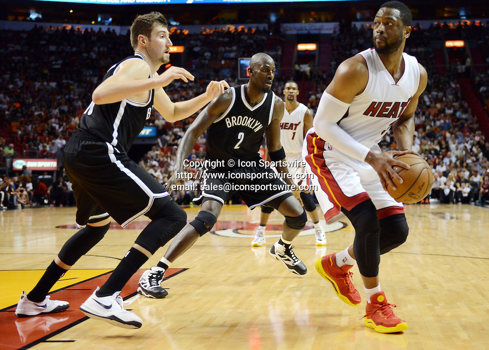 Jan. 4, 2015 - Miami, FL, USA - Miami Heat's Dwyane Wade takes a step back to shoot against the Brooklyn Nets on Sunday, Jan. 4, 2015, at AmericanAirlines Arena in Miami
