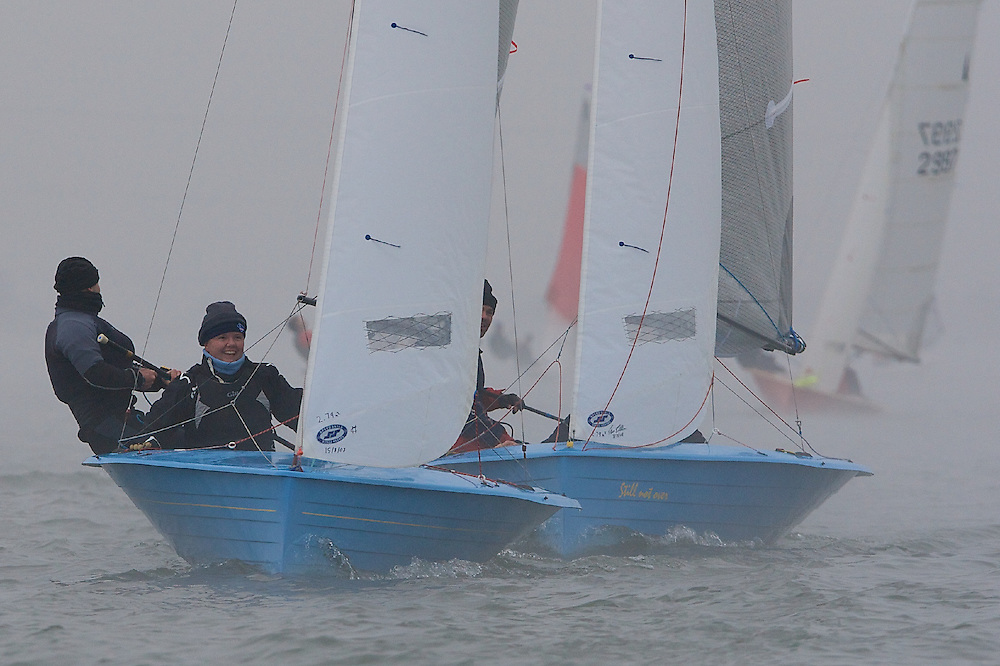 ENGLAND, London, Queen Mary Sailing Club, January 10th 2009, Bloody Mary Pursuit Race, Merlin Rocket 3656, James Stewart and Ruth Johnson (Frensham Pond SC), being chased by Merlin Rocket 3665, Ross Jackson and Liam Dempsey (Shoreham SC)
