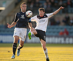 Dundee's Gavin Rae and Falkirk's Conor McGrandles.<br /> Dundee 1 v 1 Falkirk, Scottish Championship game at Dundee's home ground Dens Park.